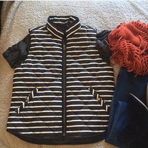 L. Black and white striped puffer vest